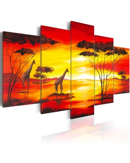 Slika Giraffes on the background with sunset